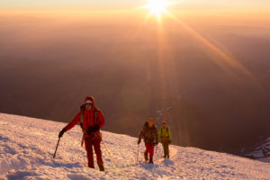 Nearing the 14,410ft summit of Mt. Rainier at sunrise is unforgettable.