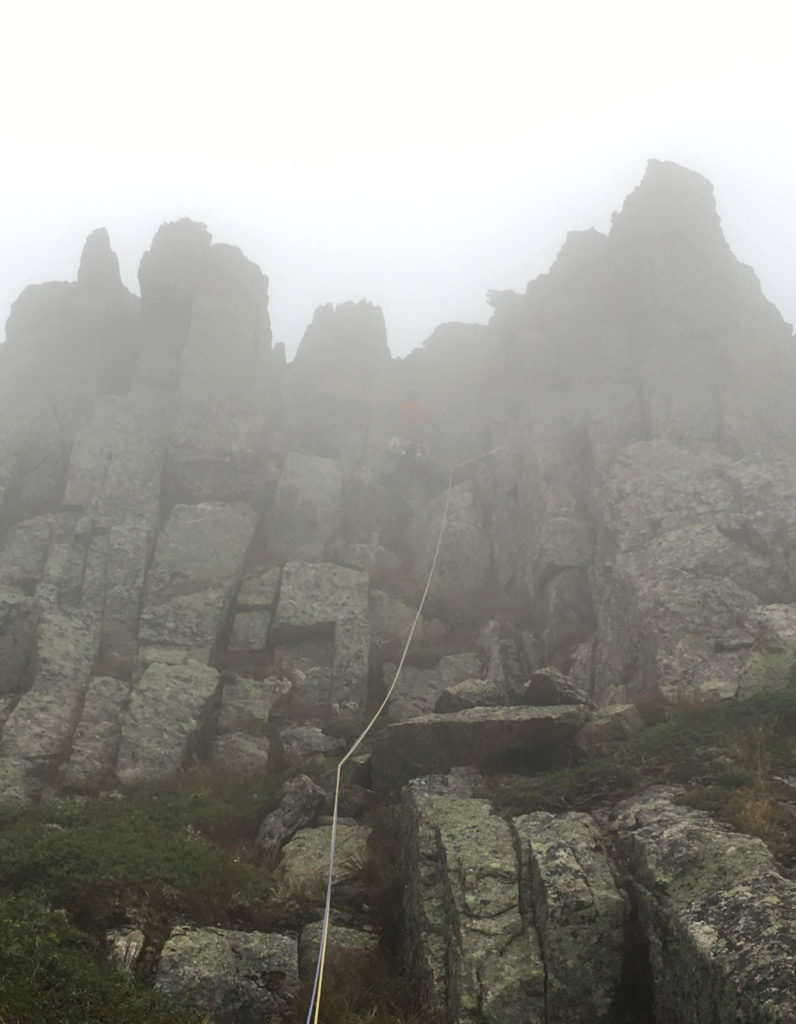 Topping out on the Knife's Edge and headed into the mist.
